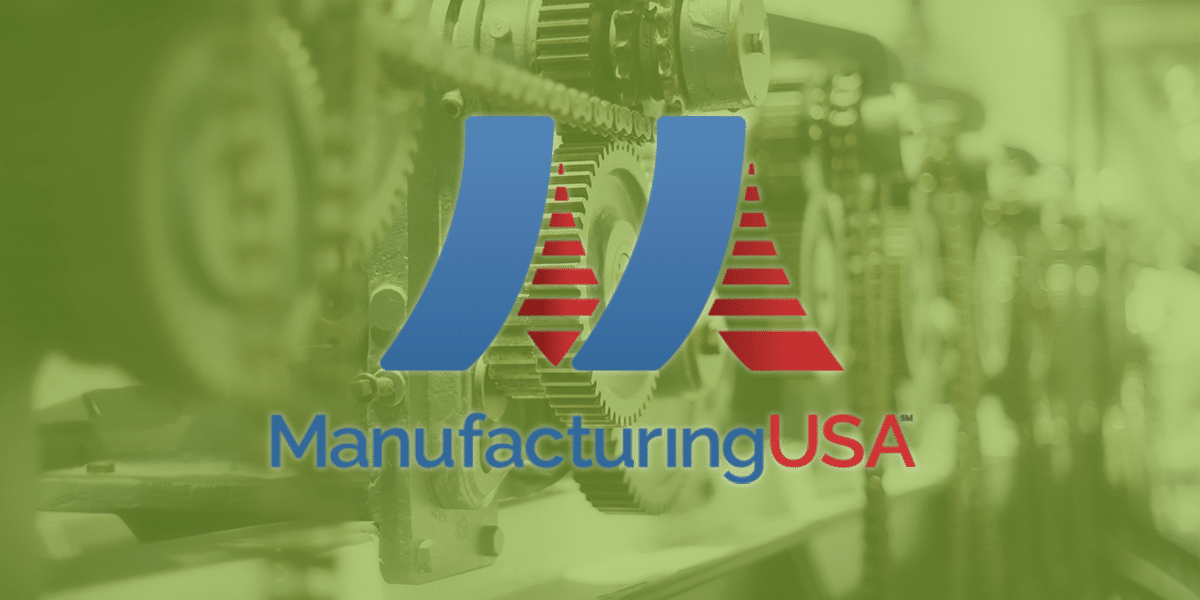 Manufacturing USA Logo infront of machine gears